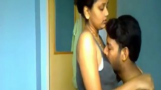 Married Indian couple seducing each other in bedroom