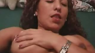 Girl pressing her boobs her self