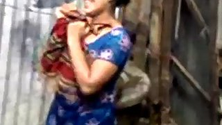 Indian village bhabhi taking open shower and drying herself off