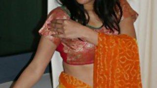 naughty looking kavya sharma showing off in sari